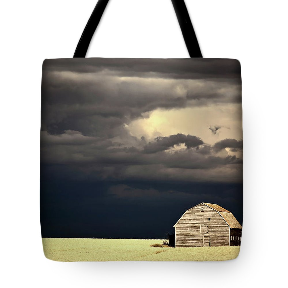 Abandoned Tote Bag featuring the digital art Storm Clouds Behind Abandoned Saskatchewan Barn by Mark Duffy