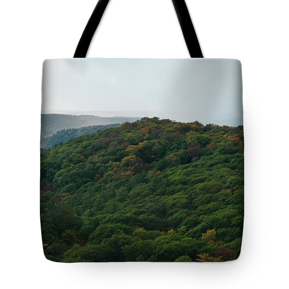 Autumn Tote Bag featuring the photograph Storm Clouds Over Fall Nature Scenery by Oleksiy Maksymenko