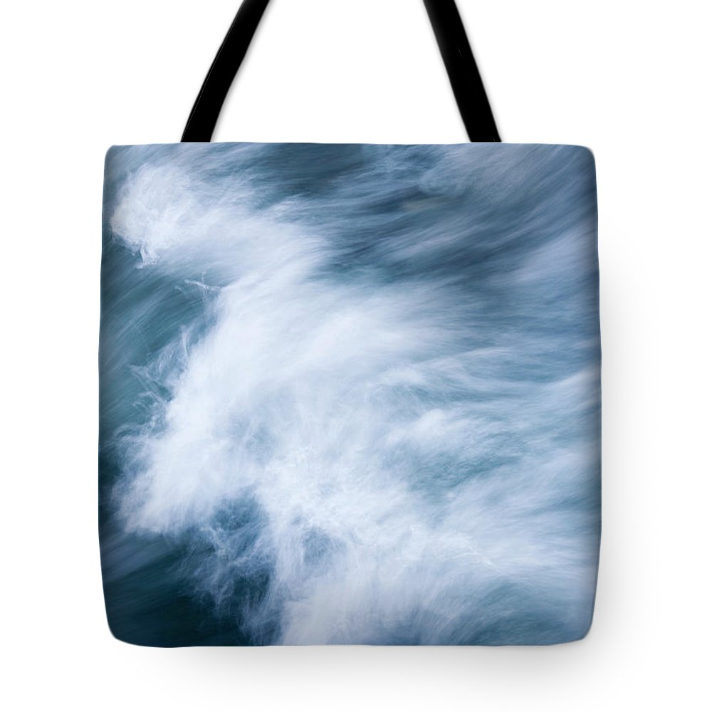 Wave Tote Bag featuring the photograph Storm Driven by Mike Dawson