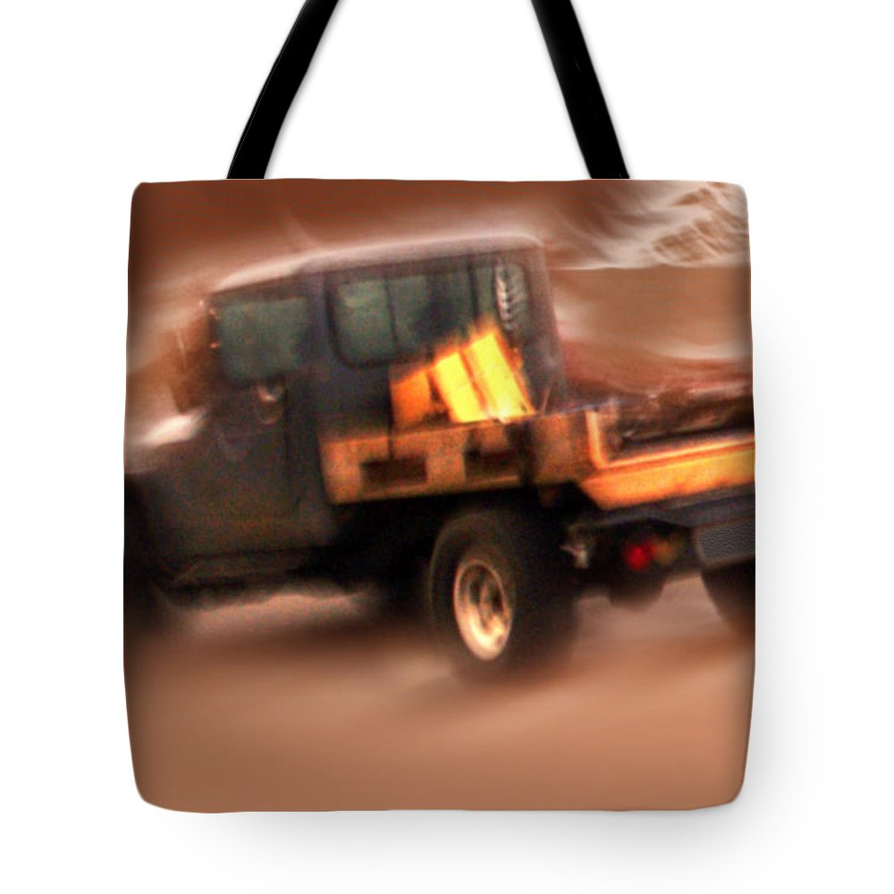 Storm Tote Bag featuring the photograph Still Truckin' by Gerry Tetz