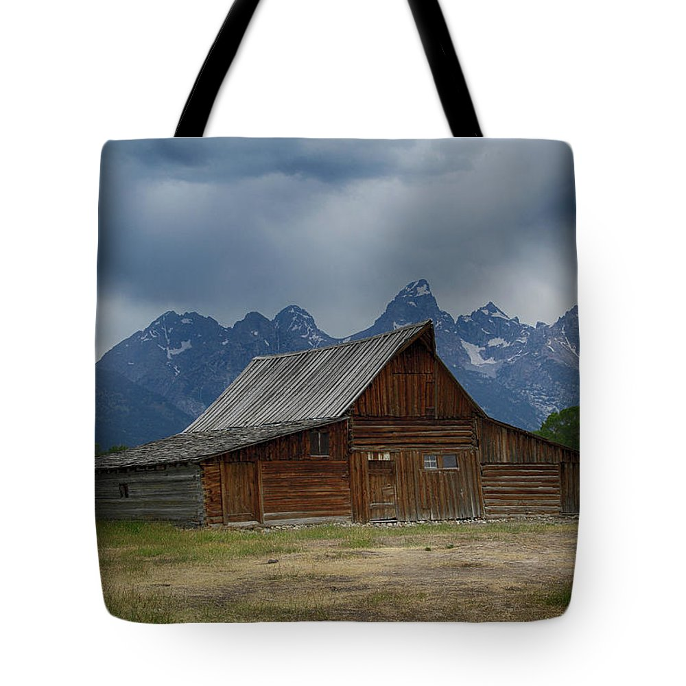 Moulton Barn Tote Bag featuring the photograph Stormy Skies Over Moulton Barn by Marie Leslie