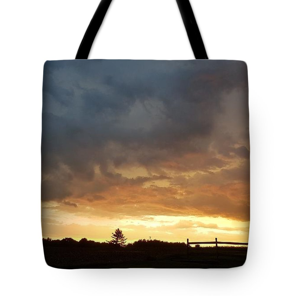 Sunset Clouds Tote Bag featuring the photograph Stormy Sunset by T Mosko