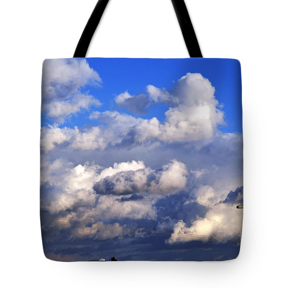 Clay Tote Bag featuring the photograph Strange Clouds by Clayton Bruster