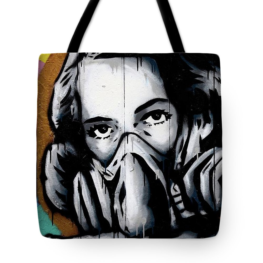 Woman tote bag featuring the photograph street art wall mural graffiti of woman wearing oxygen gas