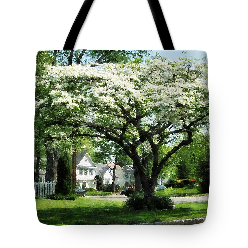 Spring Tote Bag featuring the photograph Street With Dogwood by Susan Savad