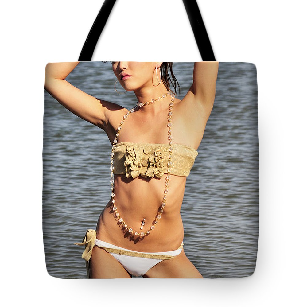 Glamour Photographs Tote Bag featuring the photograph Striking by Robert WK Clark
