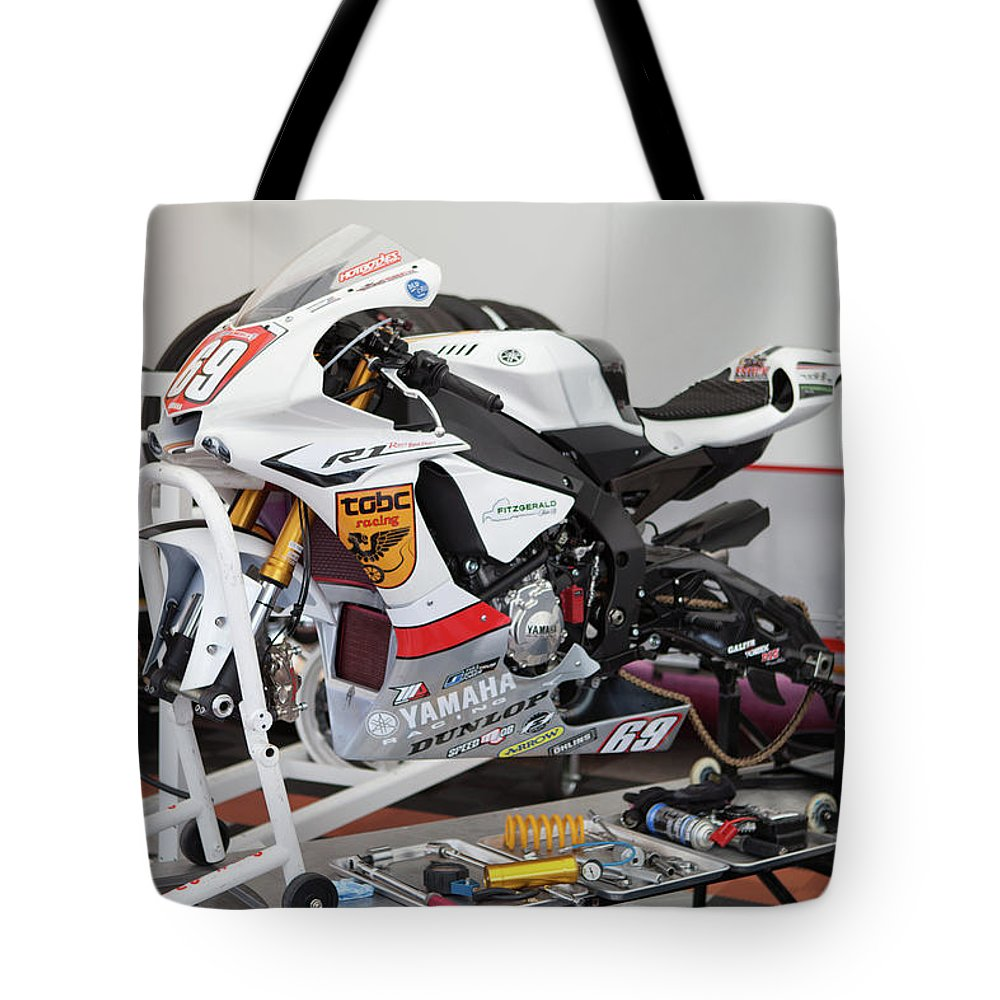 Moto Gp Tote Bag featuring the photograph Stripped Down by Timothy Lauzon