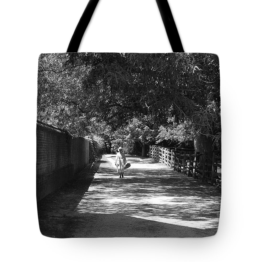 Colonial Tote Bag featuring the photograph Stroll To Store by Eric Liller