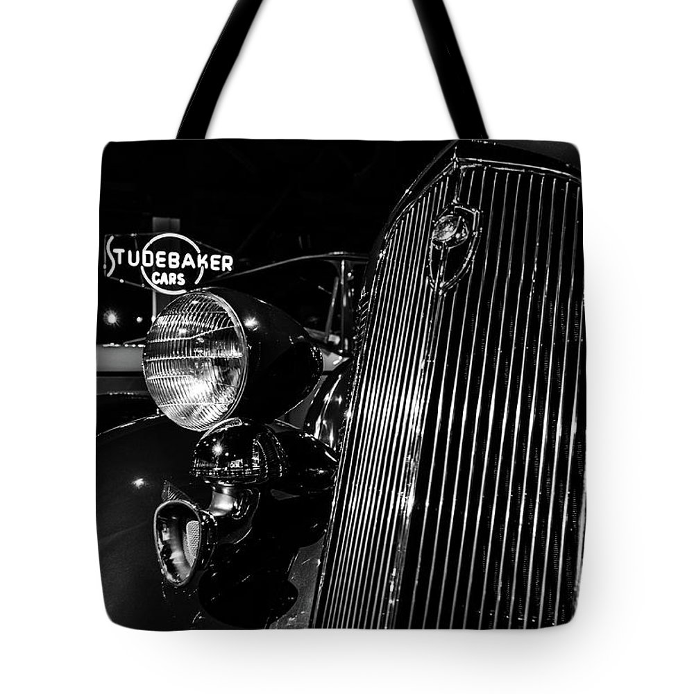 Studebaker Tote Bag featuring the photograph Studebaker Chrome by Steven Heim