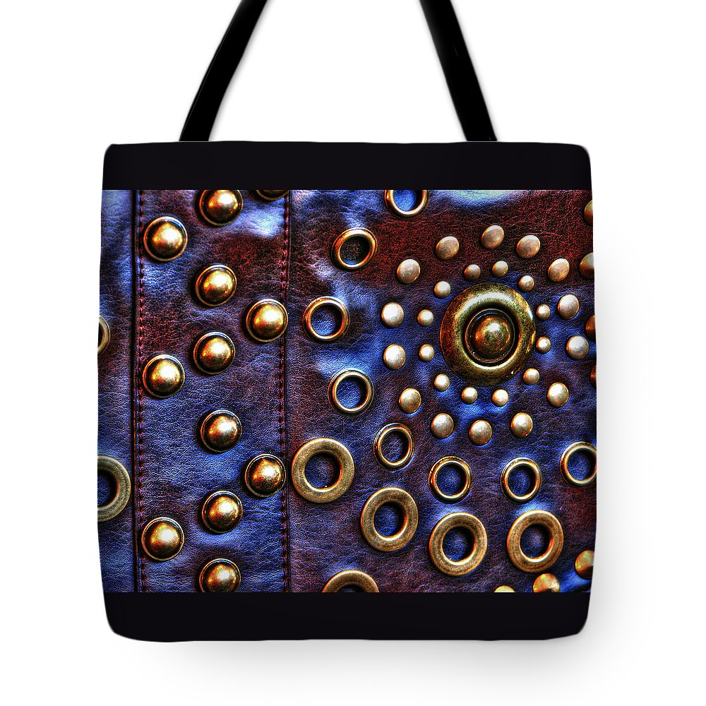 Hand-held Tote Bag featuring the photograph Studs On Leather by Chris Anderson