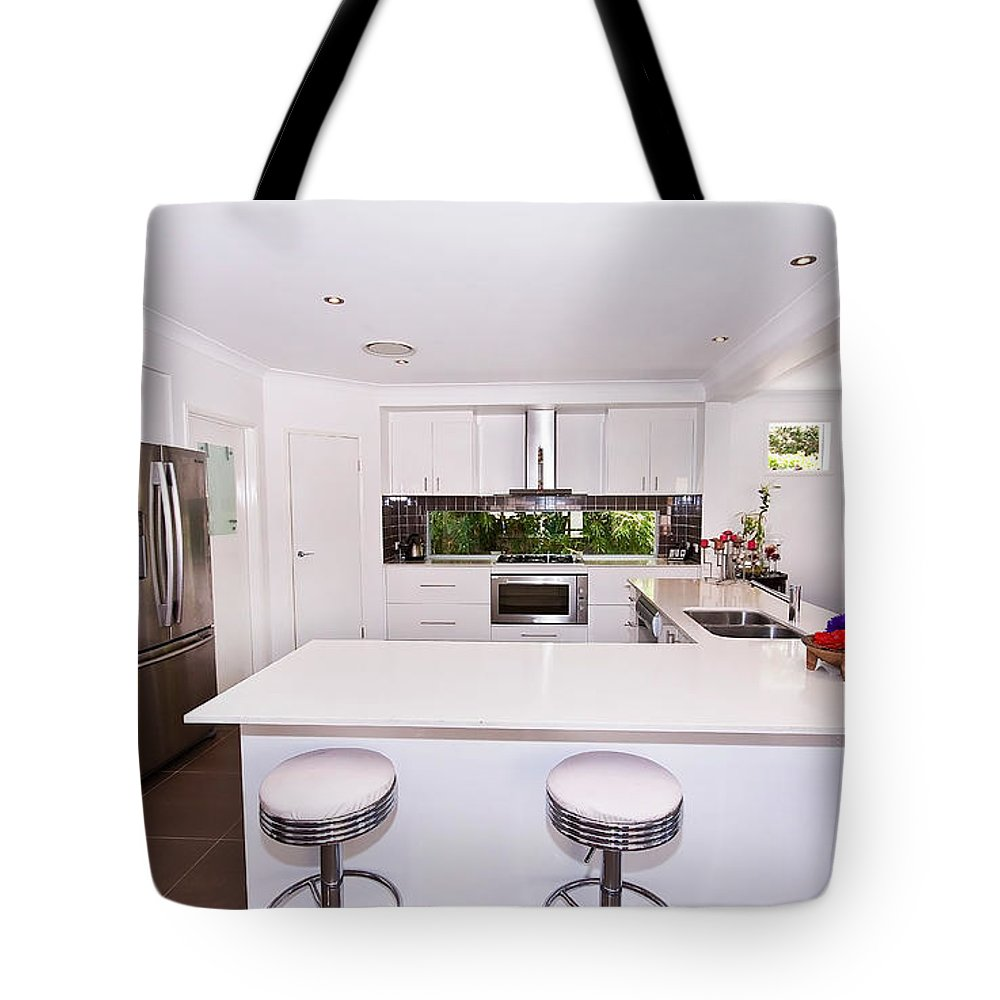 Stylish Tote Bag featuring the photograph Stylish Modern Kitchen by Darren Burton