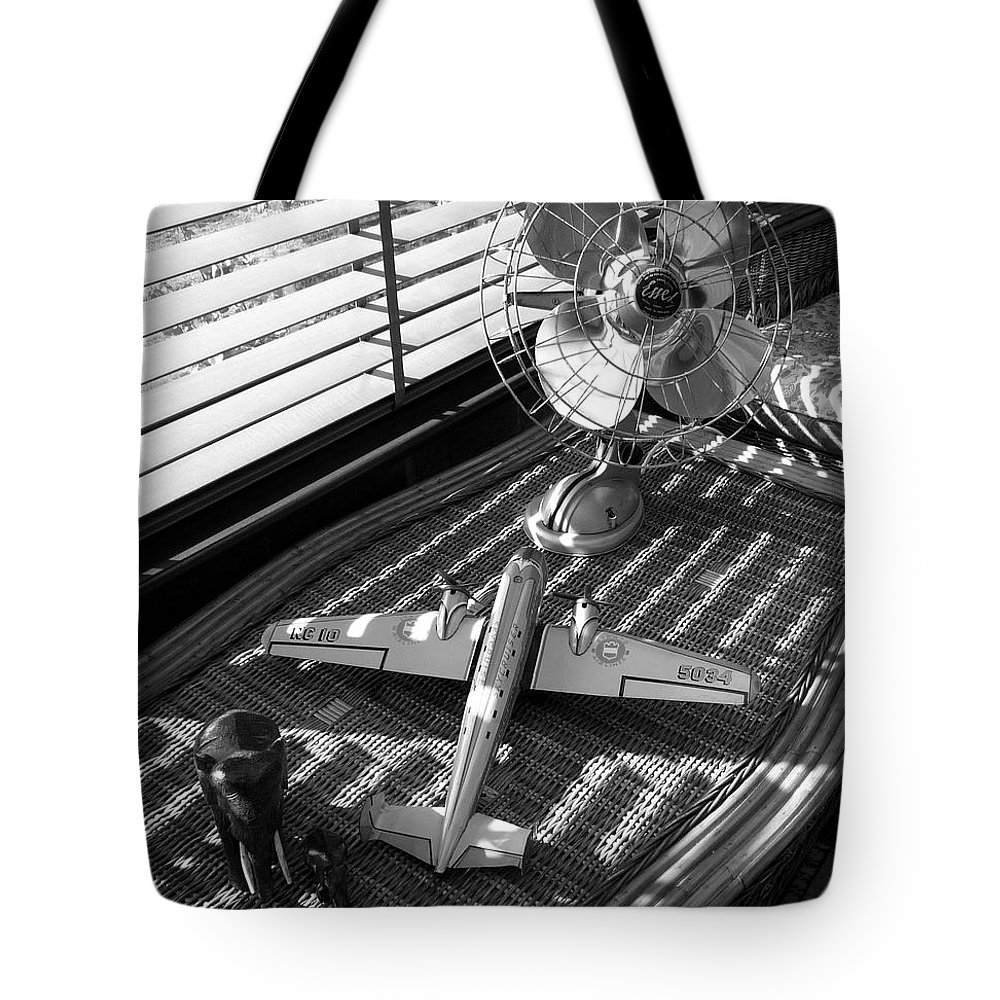 Still Life Tote Bag featuring the photograph Suburban Runway by Charles Stuart