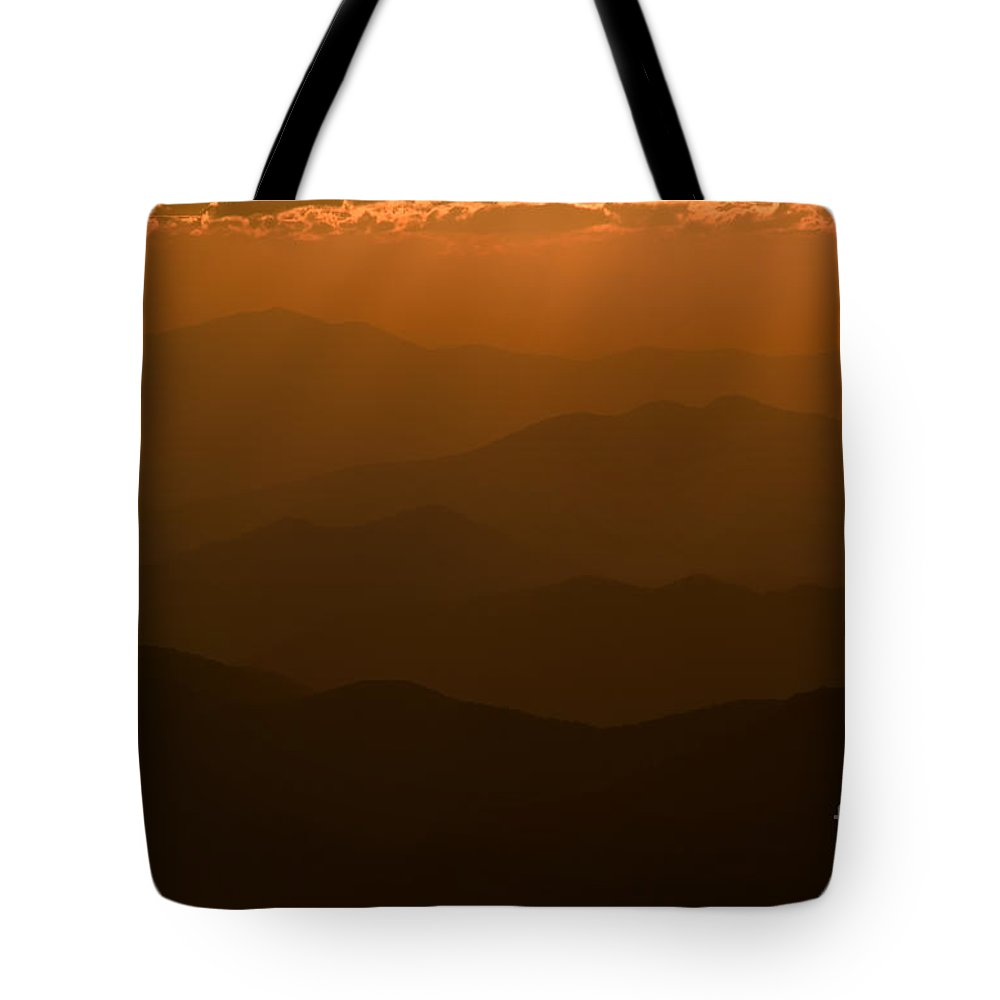 Clarence Holmes Tote Bag featuring the photograph Sun Rays At Sunset I by Clarence Holmes