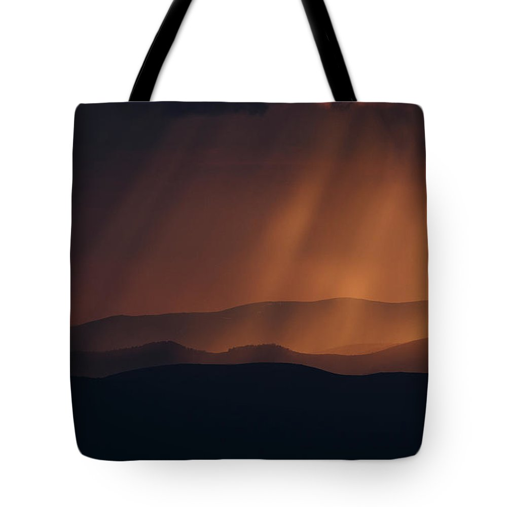 Evening Tote Bag featuring the photograph Sun Rays by Clem Onojeghuo