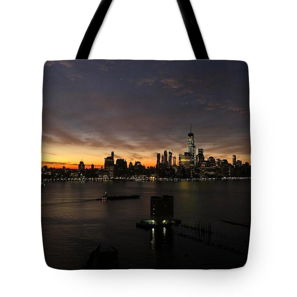 Nyc Sunrise Tote Bag featuring the photograph Sun Rise by Rolando Corella