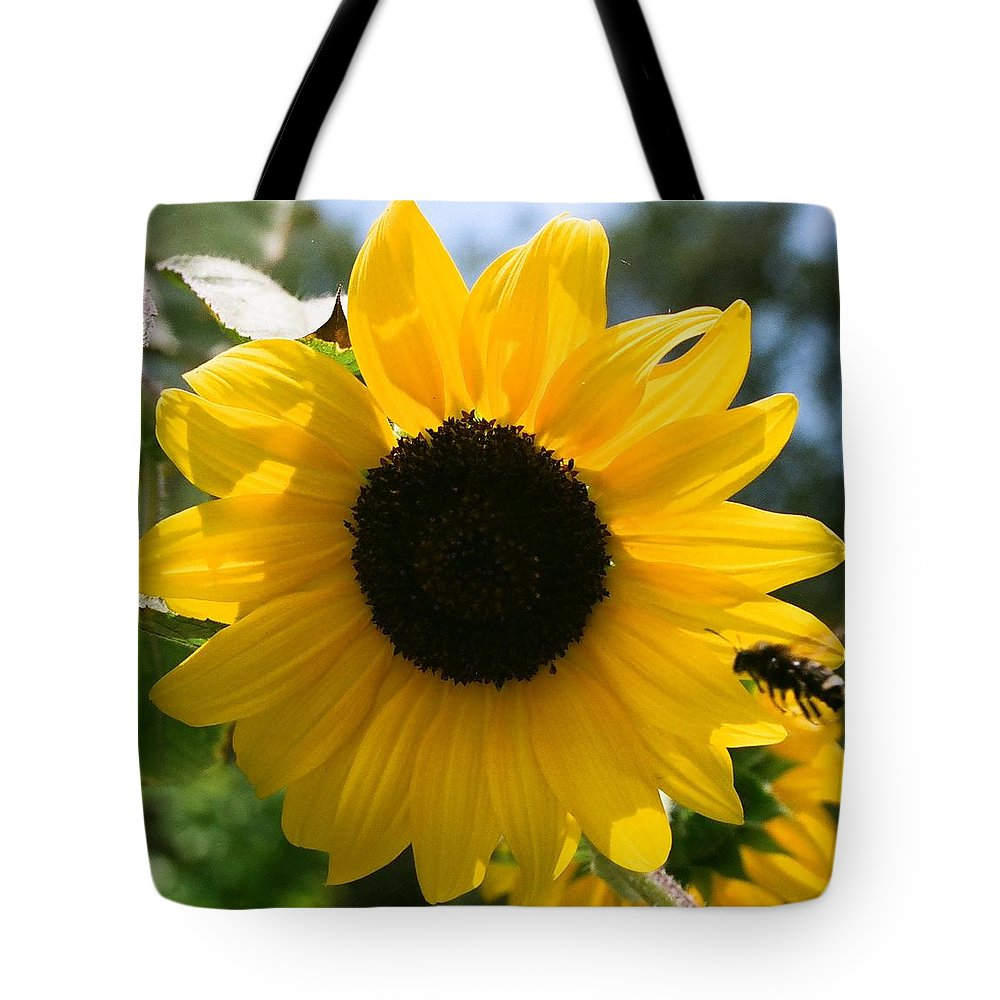 Flower Tote Bag featuring the photograph Sunflower With Bee by Dean Triolo