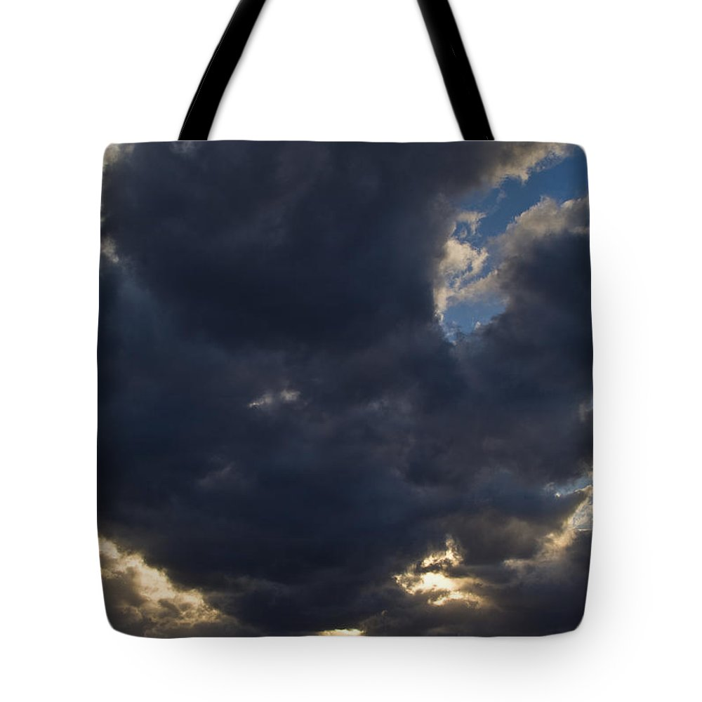 Caribbean Sea Tote Bag featuring the photograph Sunlight Through Dramatic Clouds by Todd Gipstein