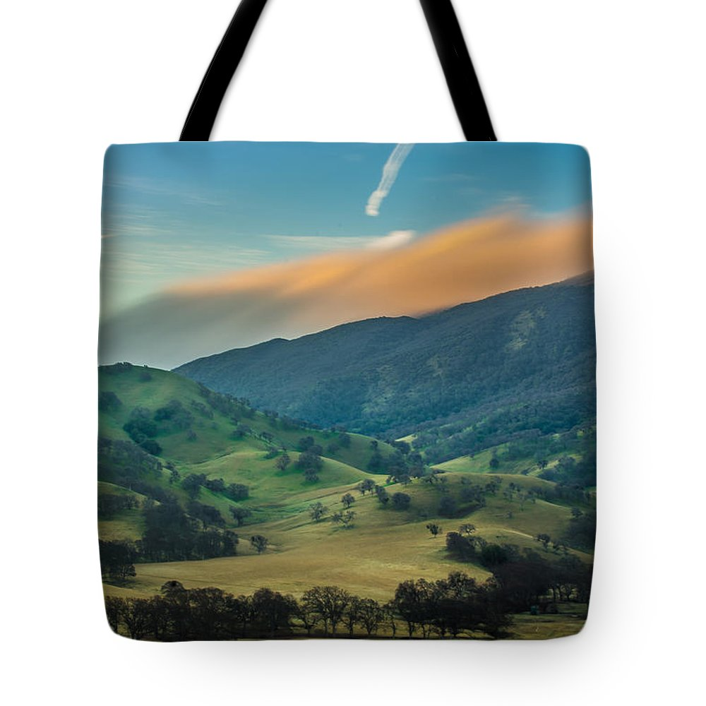 Landscape Tote Bag featuring the photograph Sunlit Clouds On A Ridge by Marc Crumpler