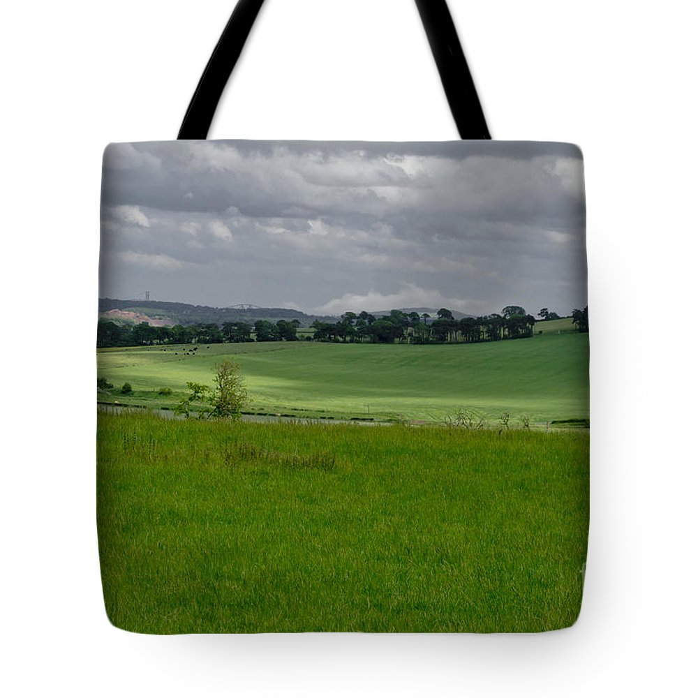 Beecraigs Tote Bag featuring the photograph Sunny Patches On The Field. by Elena Perelman
