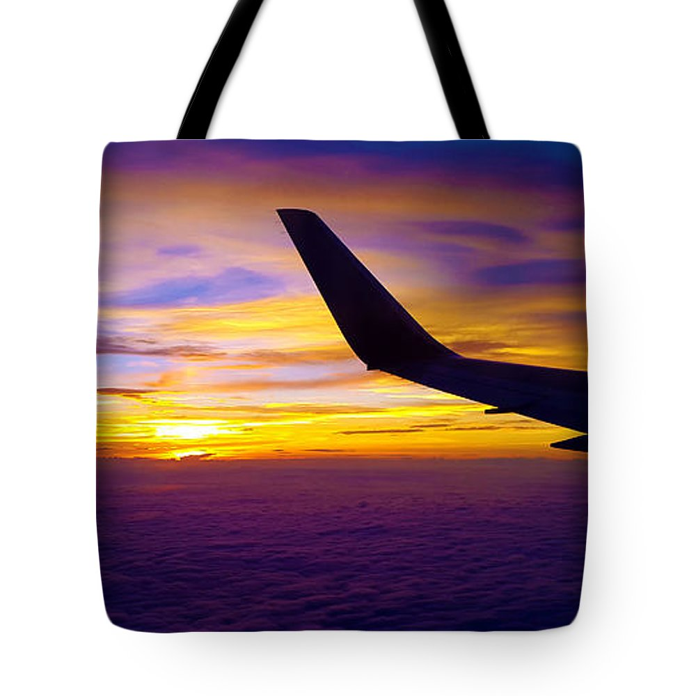 Sunrise Tote Bag featuring the photograph Sunrise Above The Clouds by Judi Saunders