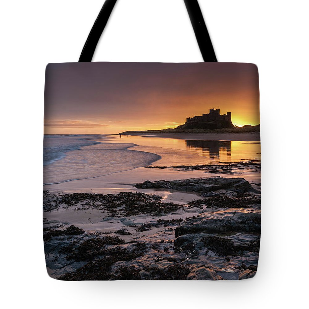 Sunrise Tote Bag featuring the photograph Sunrise at Bamburgh Castle #4, Northumberland, North East England by Anthony Lawlor