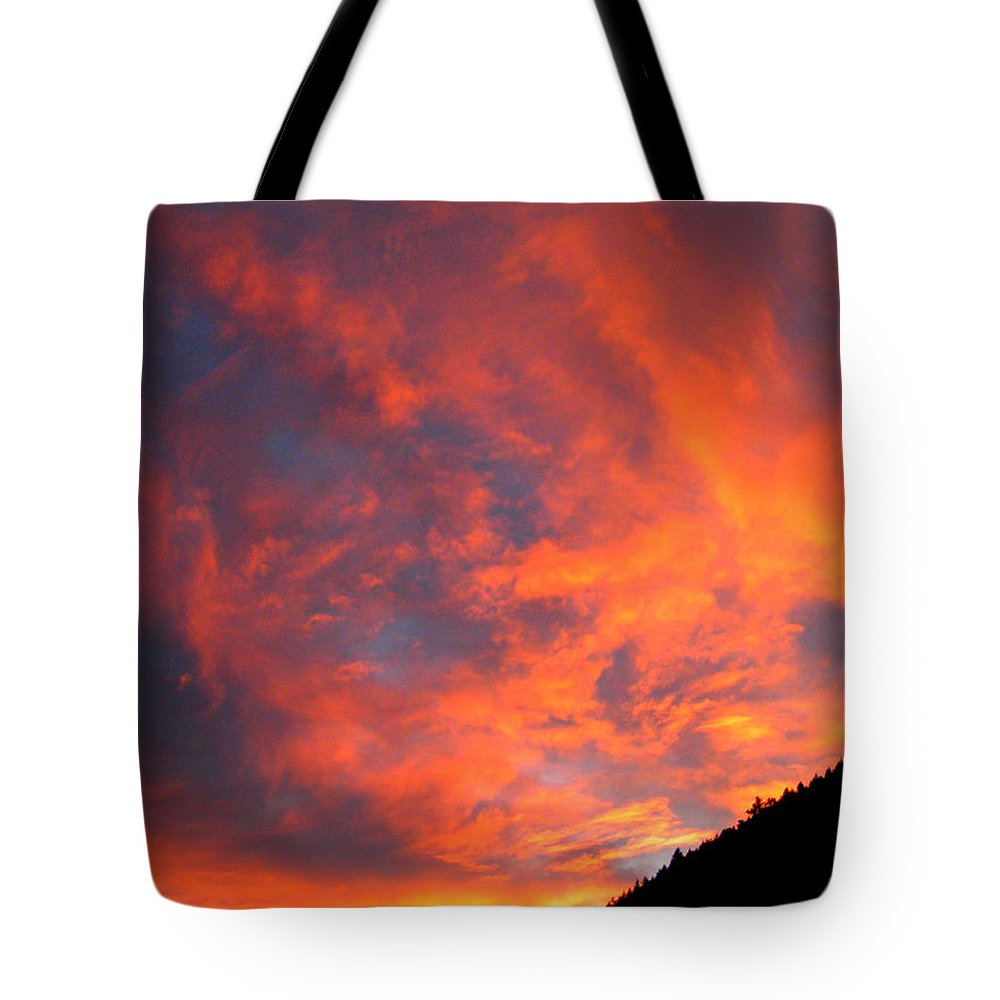 Sunrise Clouds Colorado Rocky Mountains Nature Zen Simple Colorful Big Sky Tote Bag featuring the photograph Sunrise by George Tuffy