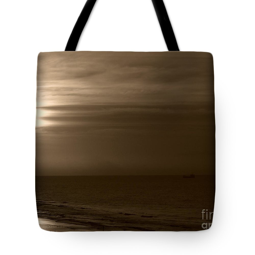 Sunrise Tote Bag featuring the photograph Sunrise In Sepia by Jeff Breiman