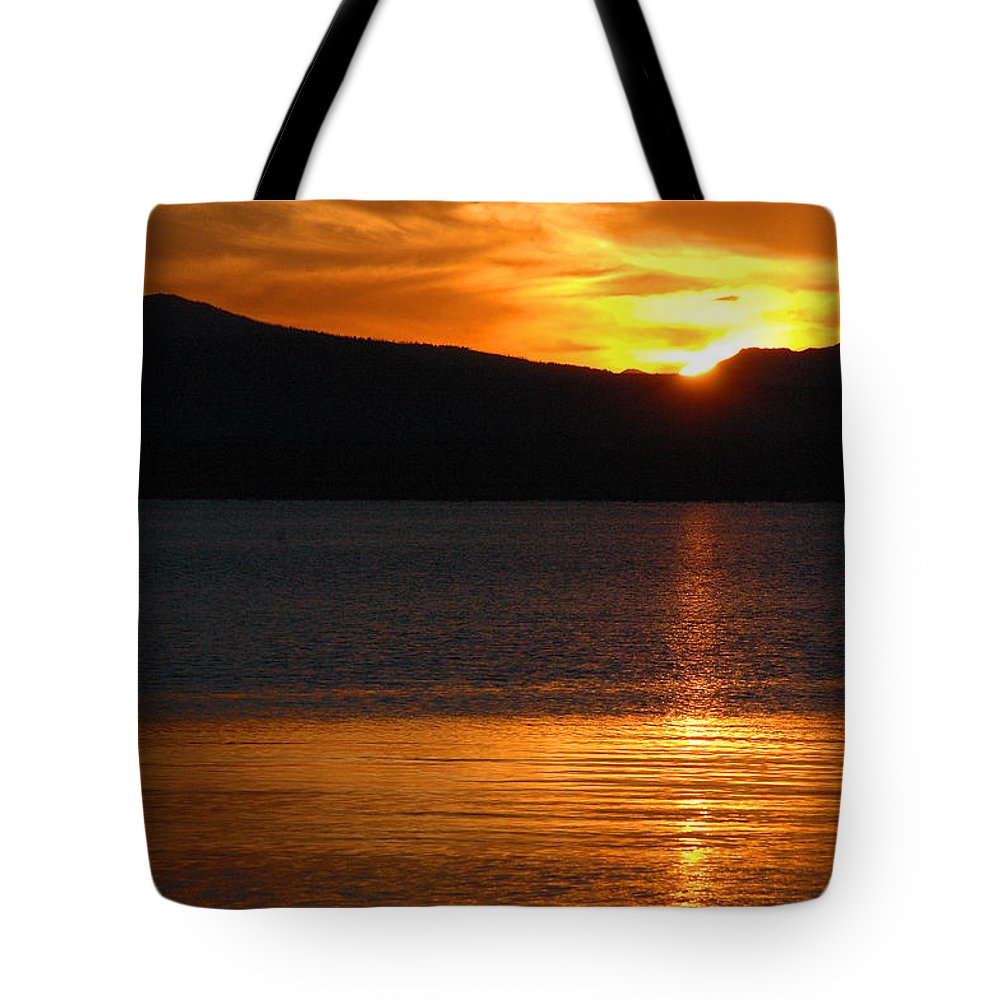 Yellowstone Tote Bag featuring the photograph Sunrise Over Yellowstone Lake by Bruce Gourley