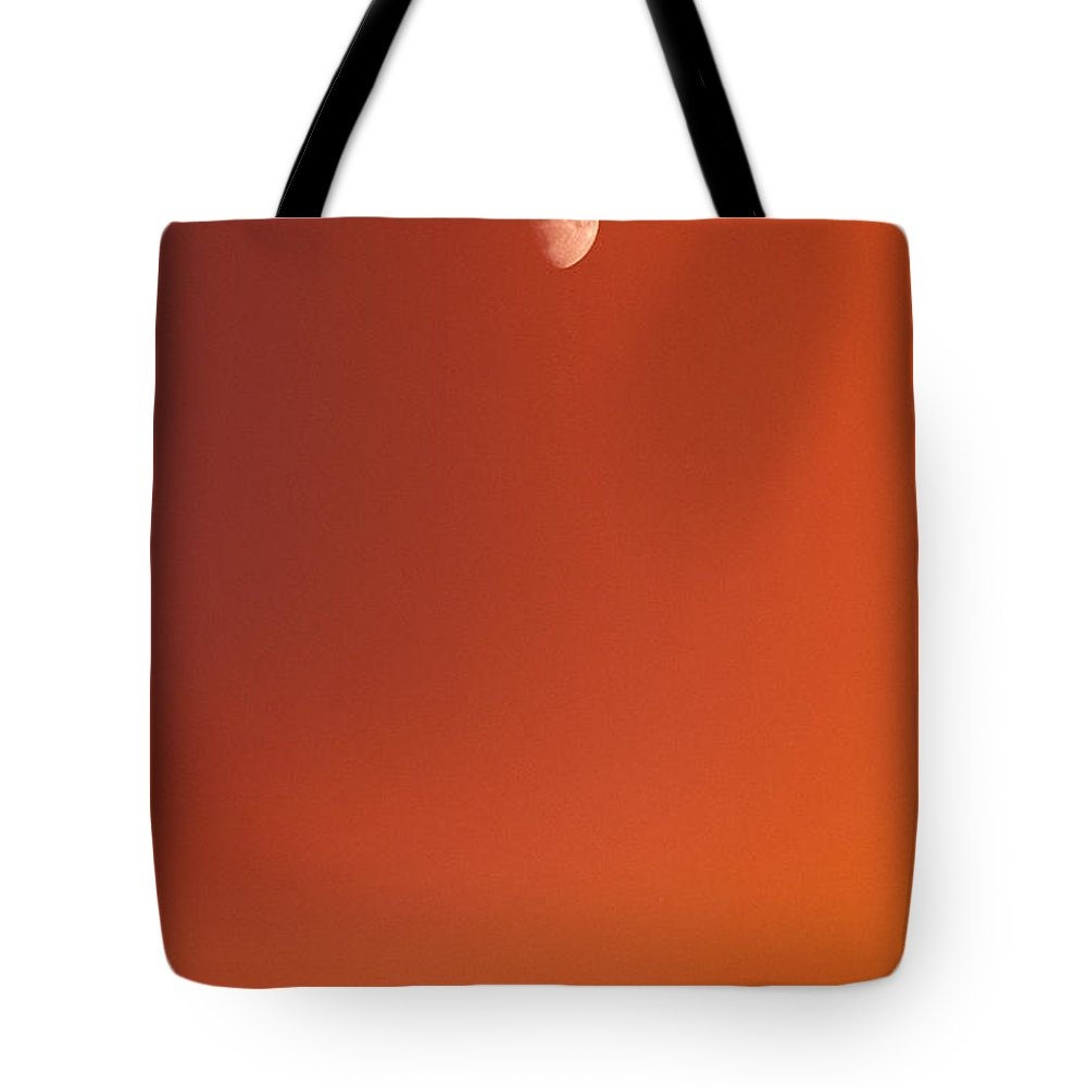 Above Tote Bag featuring the photograph Sunset And Half Moon by Carl Shaneff - Printscapes