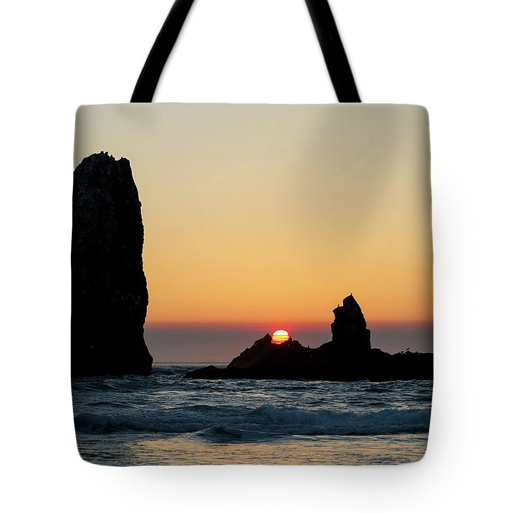 Sunset Tote Bag featuring the photograph Sunset At Cannon Beach by David Gn