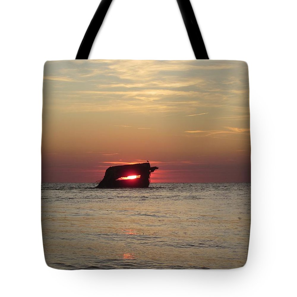 Shipwreck Tote Bag featuring the pyrography Sunset Beach by Fredrecka Bagnato