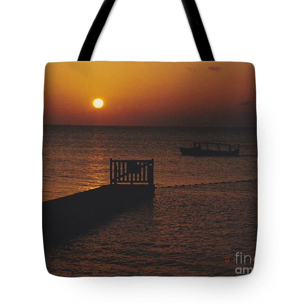Sunsets Tote Bag featuring the photograph Sunset Boat by Michelle Powell