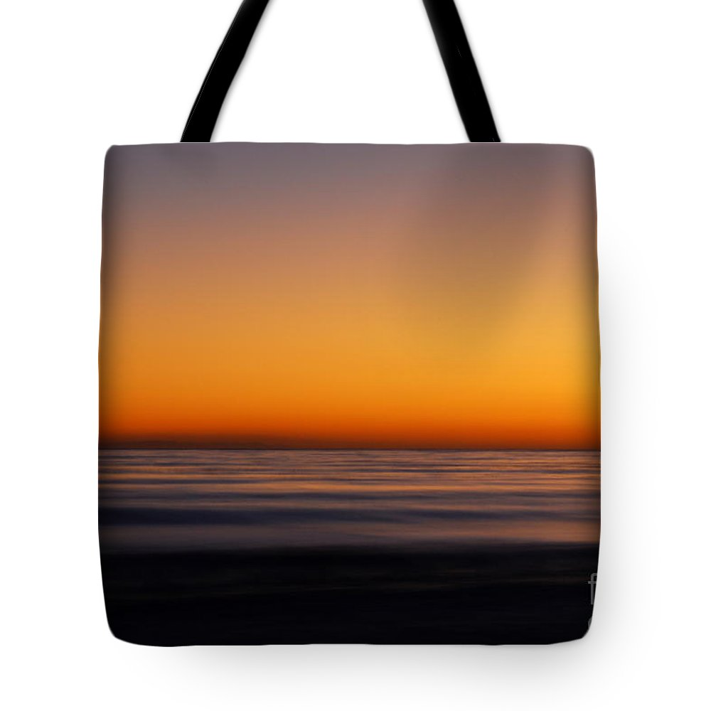 Seascape Tote Bag featuring the photograph Sunset by Catherine Lau