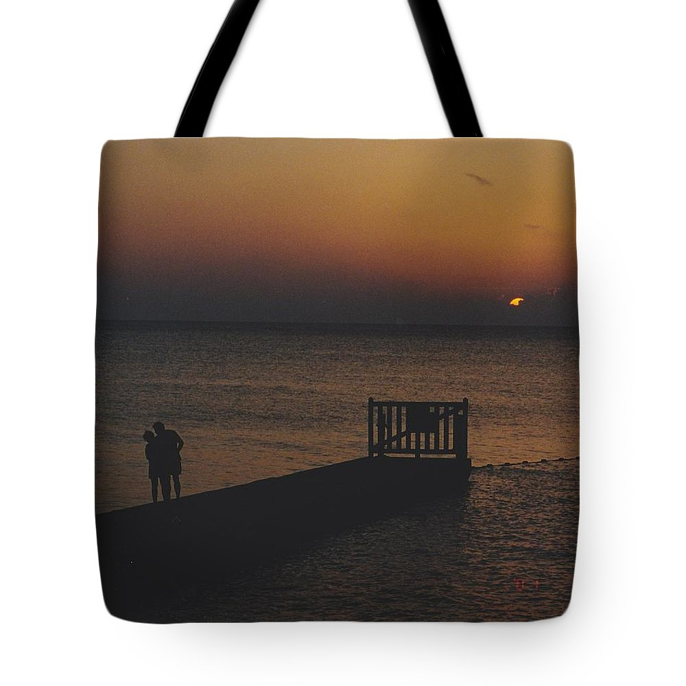 Sunsets Tote Bag featuring the photograph Sunset Couple by Michelle Powell