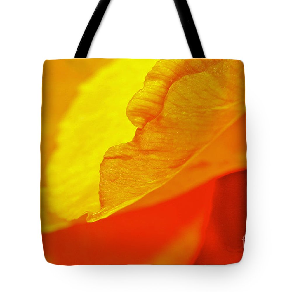 Flower Tote Bag featuring the photograph Sunset Flower by Michael Cinnamond