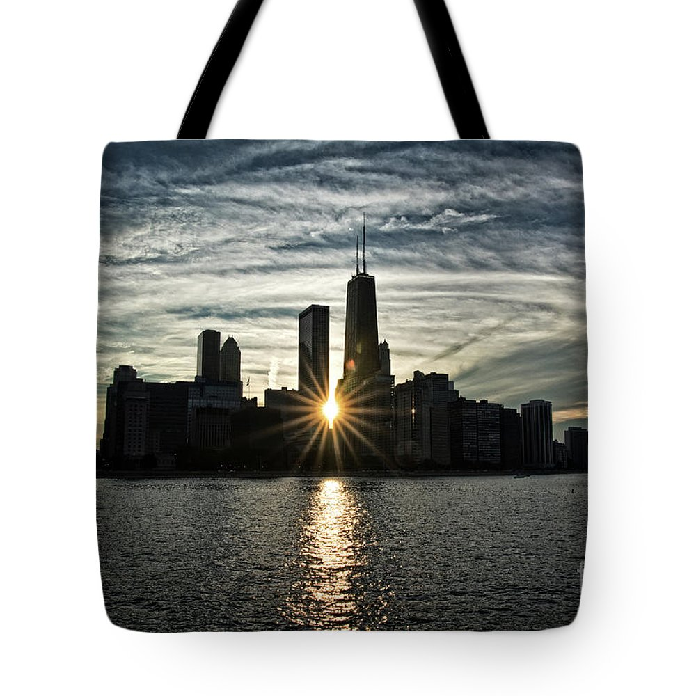 Skyline Tote Bag featuring the photograph Sunset Over Chicago Skyline And Lake Michigan by Bruno Passigatti