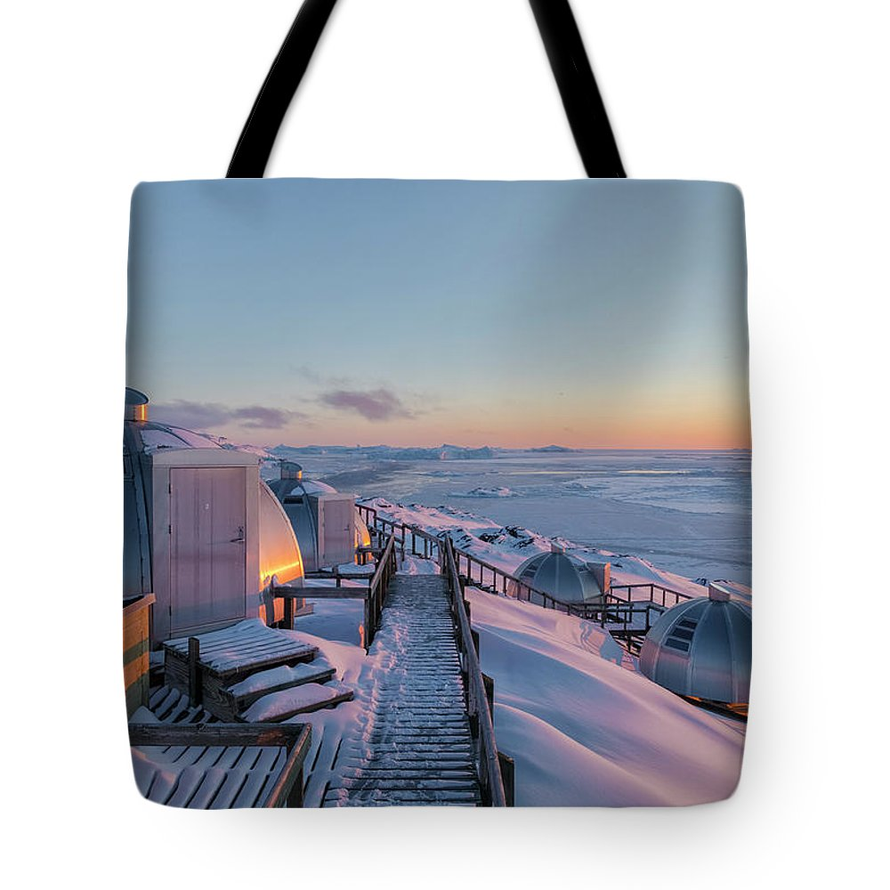 Ilulissat Tote Bag featuring the photograph sunset over Igloos - Greenland by Joana Kruse