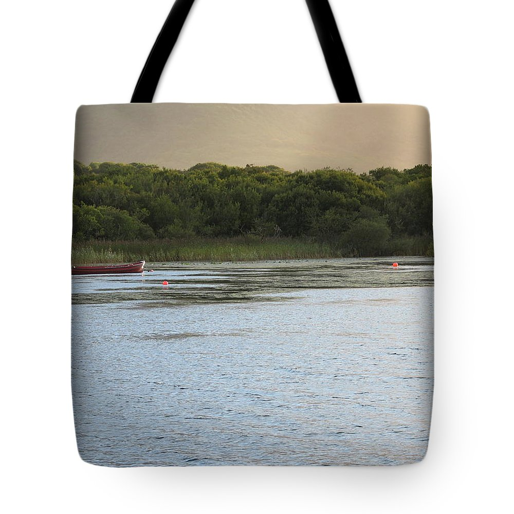 Boat Tote Bag featuring the photograph Sunset Over Killarney by Kelly Mezzapelle