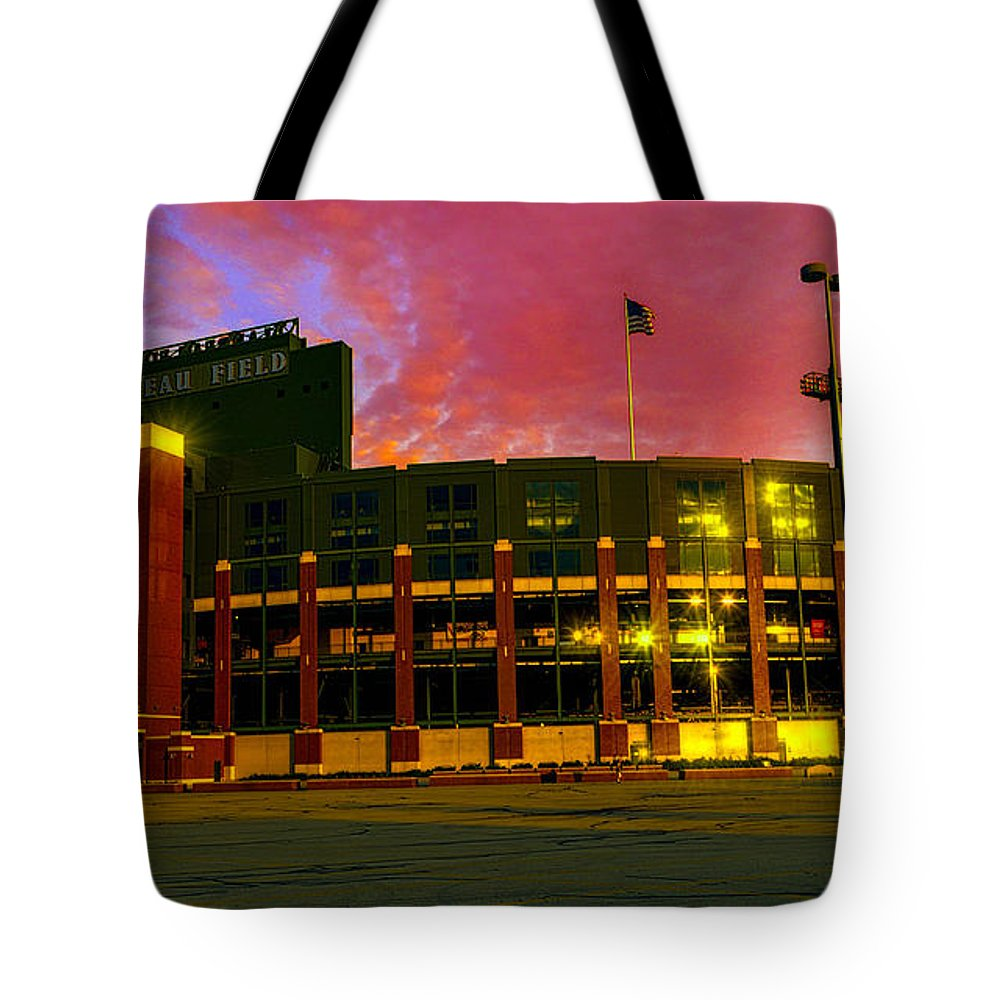 Football Tote Bag featuring the photograph Sunset Over Lambeau Field by Tommy Anderson