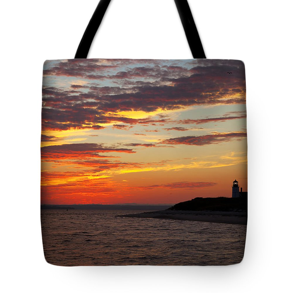 Sunset Tote Bag featuring the photograph Sunset Over Sandy Neck Lighthouse by Charles Harden
