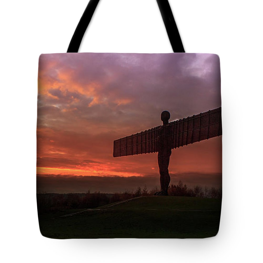 Sunset Tote Bag featuring the photograph Sunset Over The Angel. by Darren Turner