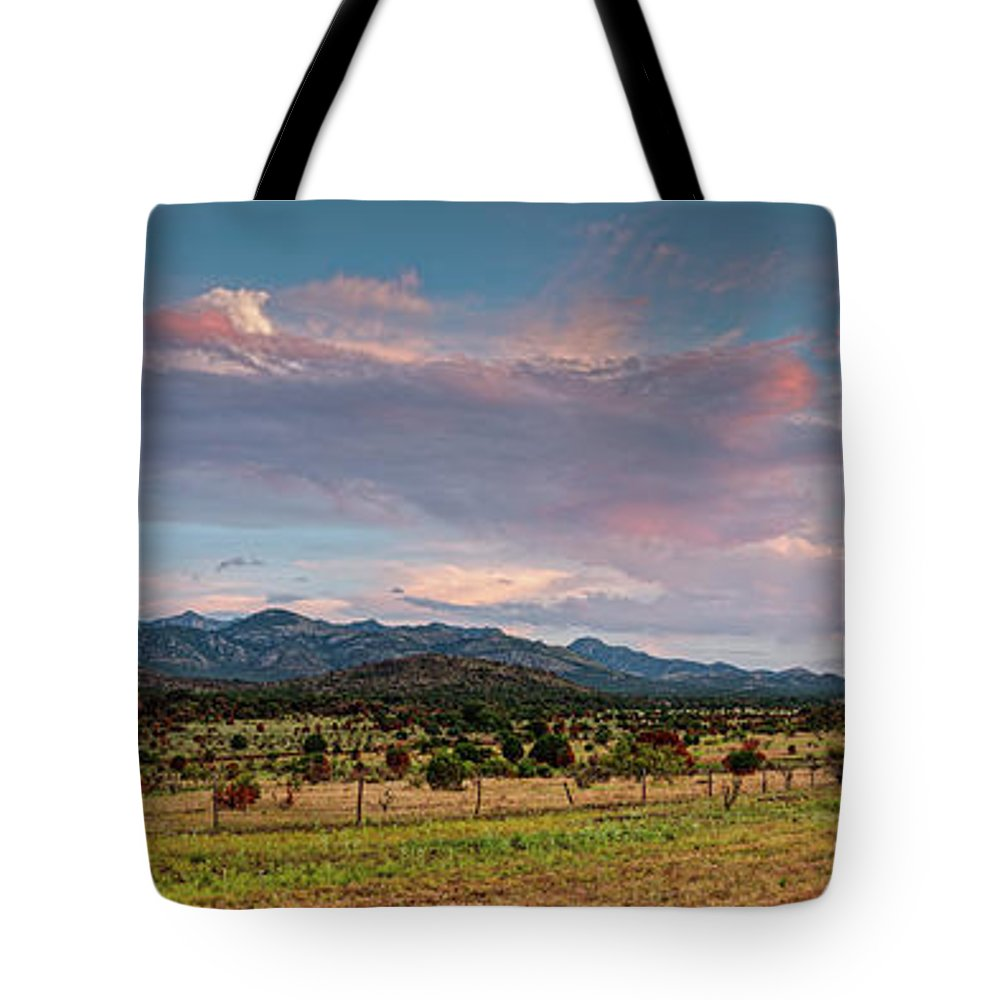 Davis Mountains Tote Bag featuring the photograph Sunset Panorama Of Sawtooth Mountain And Davis Mountains Preserve - Nature Conservancy West Texas by Silvio Ligutti