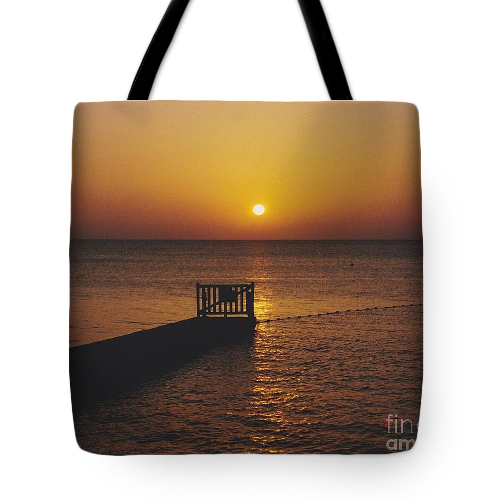 Sunsets Tote Bag featuring the photograph Sunset Pier by Michelle Powell
