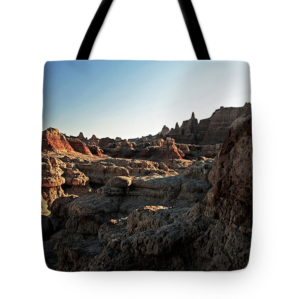 Badlands National Park Tote Bag featuring the photograph Sunset Shadows In The Badlands by Glenn W Smith