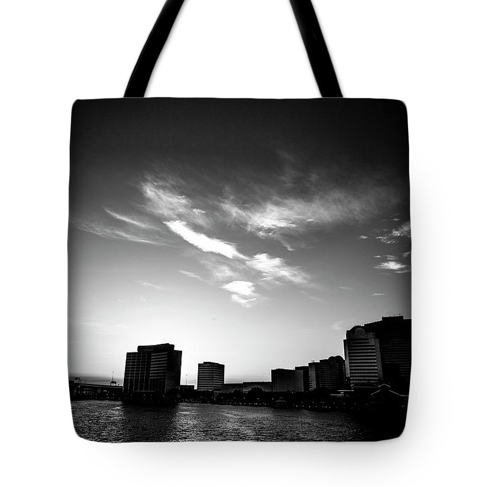 Cityscape Tote Bag featuring the photograph Sunset Silhouette by Eric Christopher Jackson