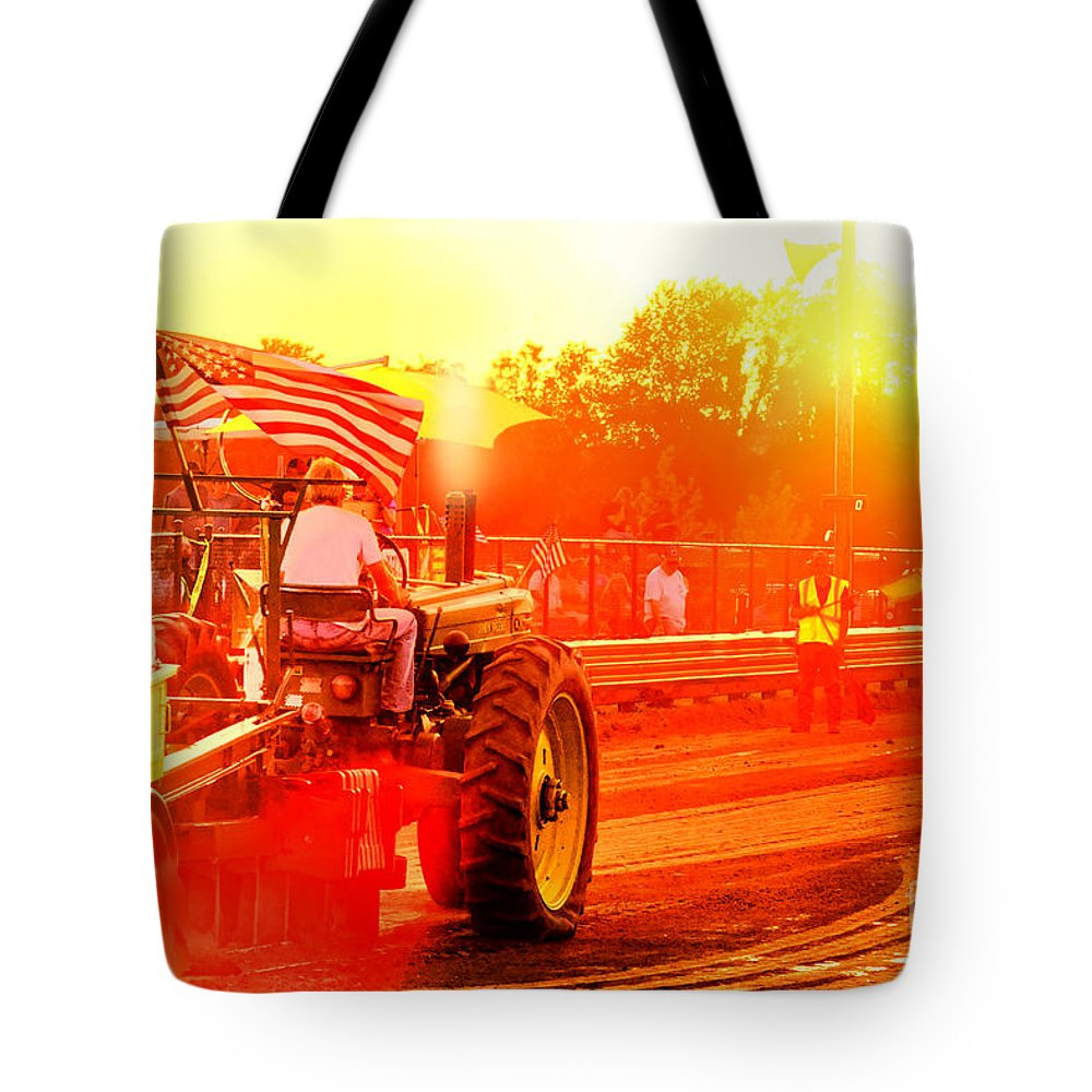 Tractor Tote Bag featuring the photograph Sunset Tractor Pull by Olivier Le Queinec