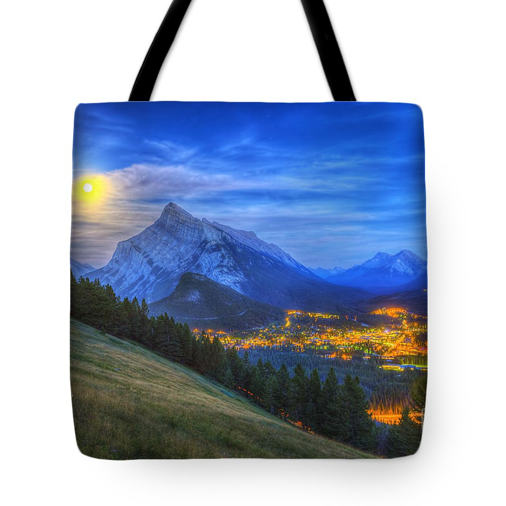 Banff Tote Bag featuring the photograph Supermoon Rising Over Mount Rundle by Alan Dyer