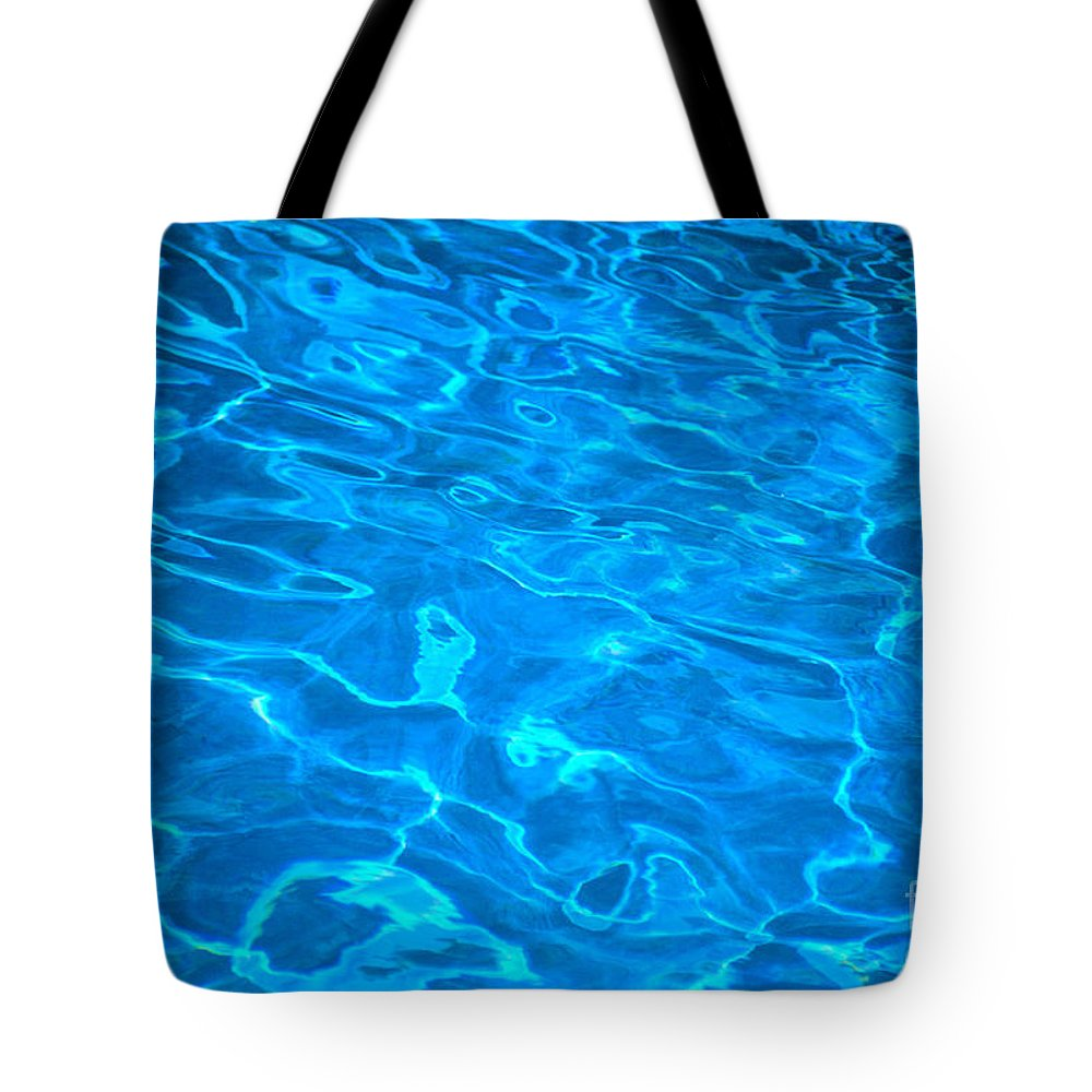 Blue Tote Bag featuring the photograph Surface Ripples by Himani - Printscapes