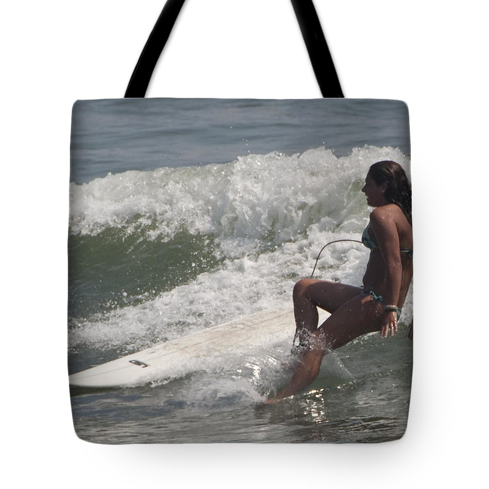 Surfing Tote Bag featuring the photograph Surfer Girl by Steven Natanson