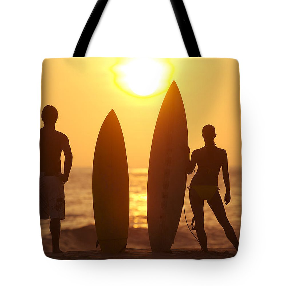 Afternoon Tote Bag featuring the photograph Surfer Silhouettes by Larry Dale Gordon - Printscapes